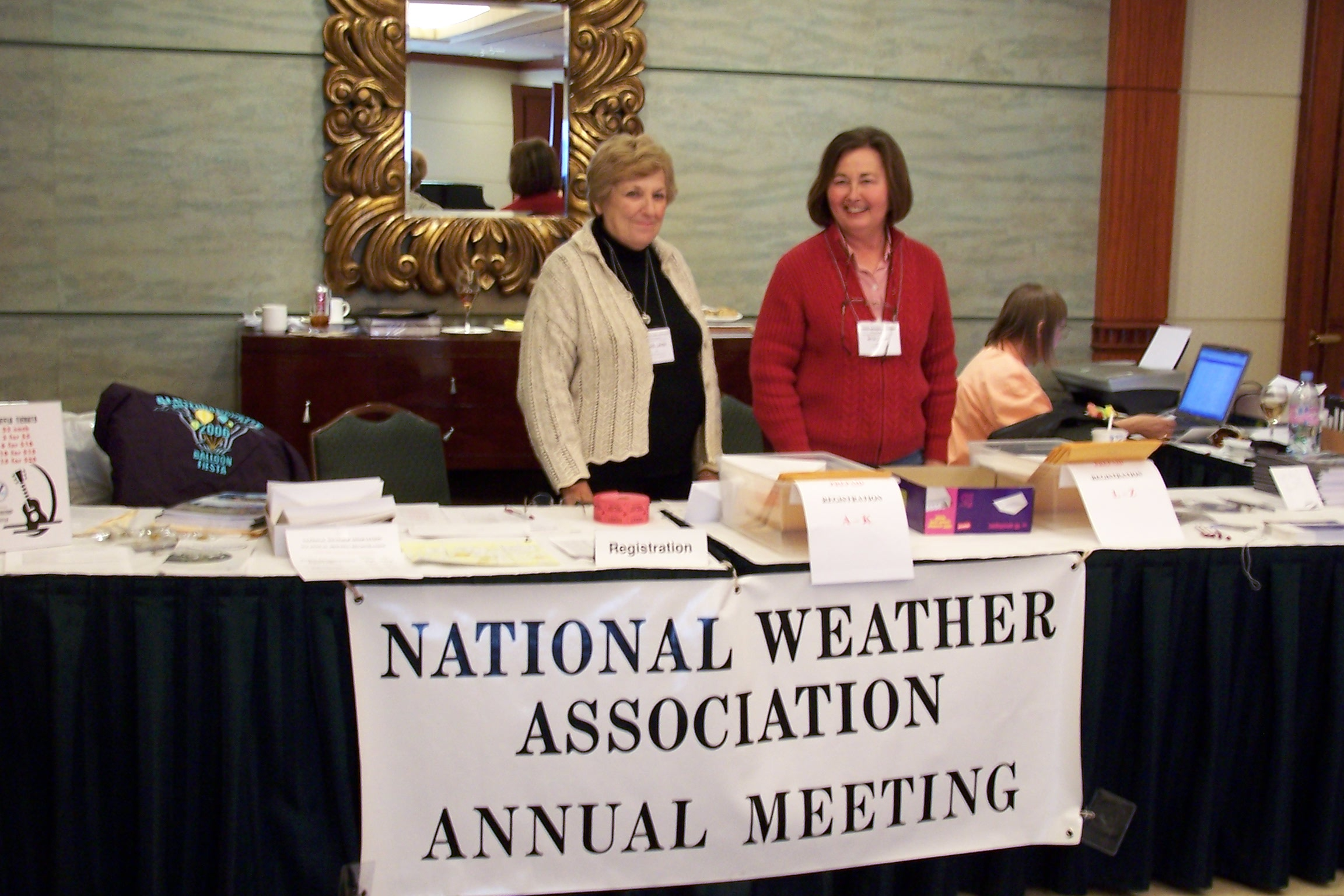 Carol Lavin stationed at a registration desk during an NWA Annual Meeting.